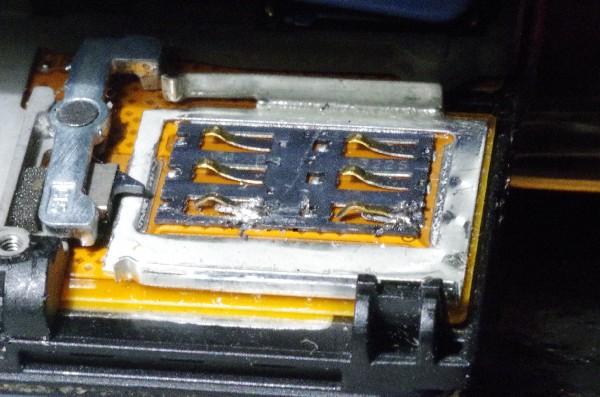 remplacement de deux broches carte SIM arachèes sur un nokia 920